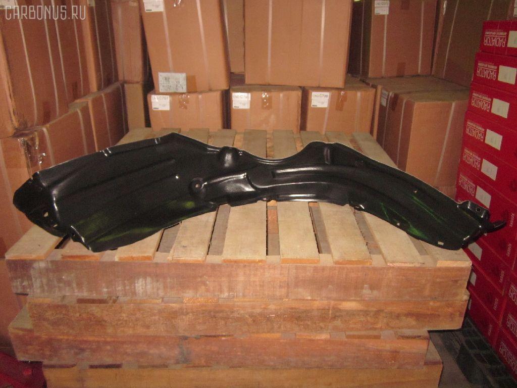 Подкрылок Toyota Vitz SCP90 Фото 1