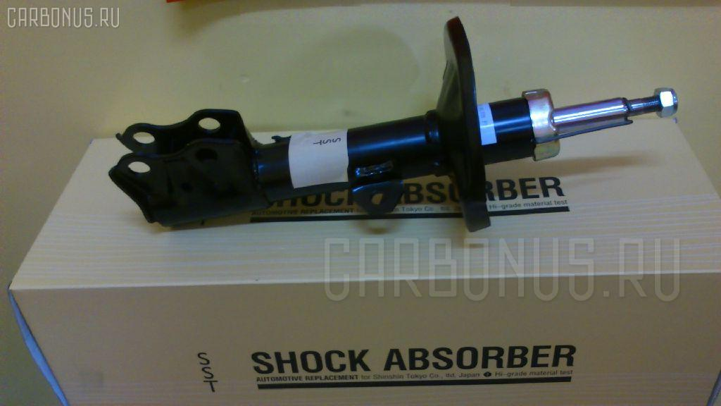 Стойка амортизатора SST ST-049FL-NZE141 на Toyota Corolla NZE141 Фото 1