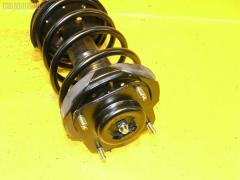 Стойка амортизатора Mazda Familia BJ3P B3 Фото 1