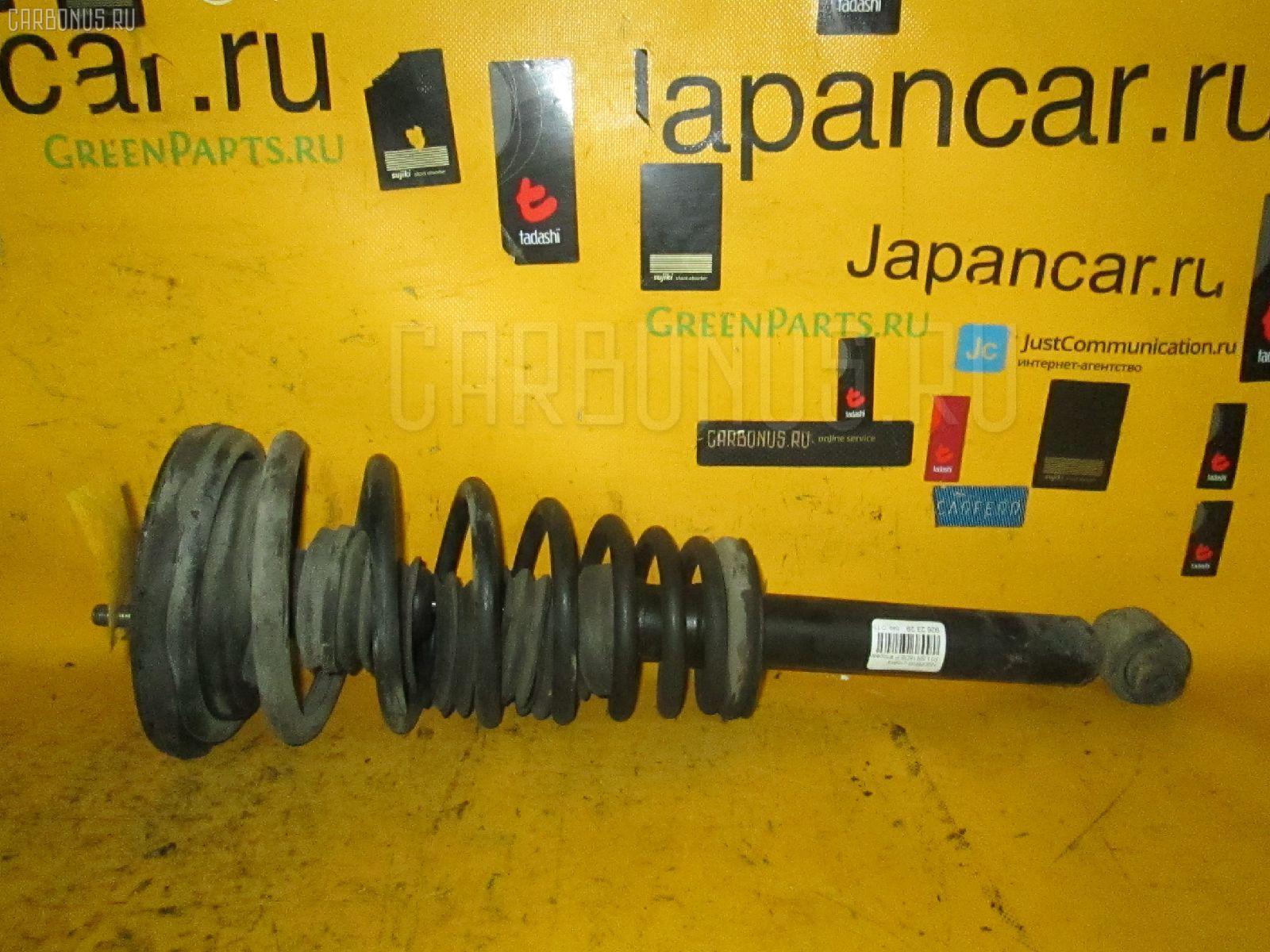 Стойка амортизатора Nissan Primera P11 SR18DE Фото 1