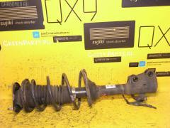 Стойка амортизатора Toyota Vitz NCP15 2NZ-FE Фото 1