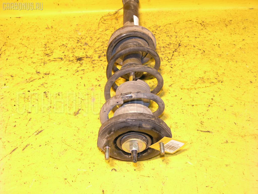 Стойка амортизатора Nissan Bluebird EU14 SR18DE Фото 1