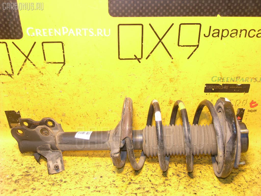 Стойка амортизатора Nissan Serena TC24 QR20DE Фото 1