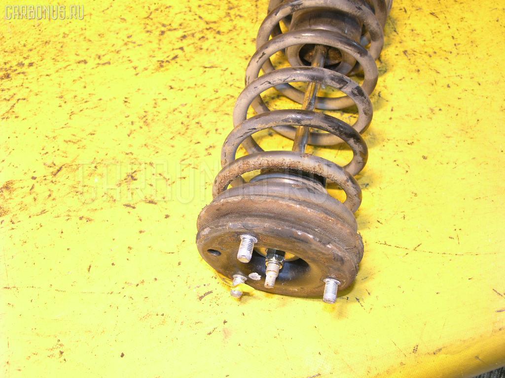 Стойка амортизатора NISSAN LAUREL GC32 VG20T Фото 1