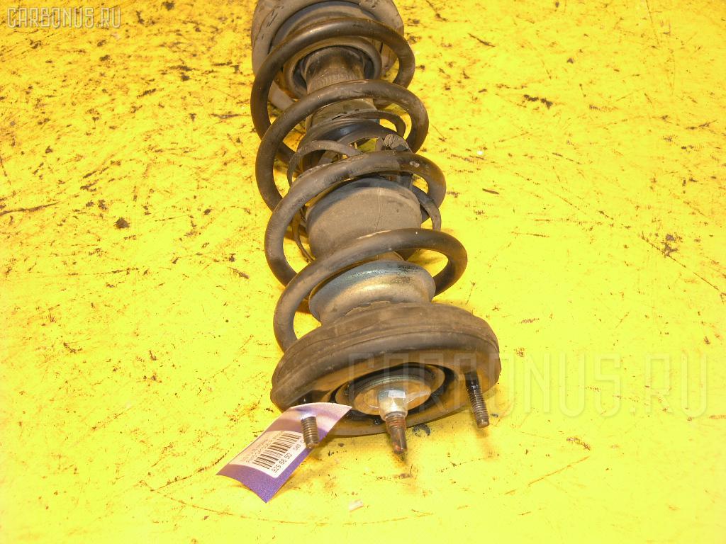 Стойка амортизатора Nissan Pulsar FN15 GA15DE Фото 1