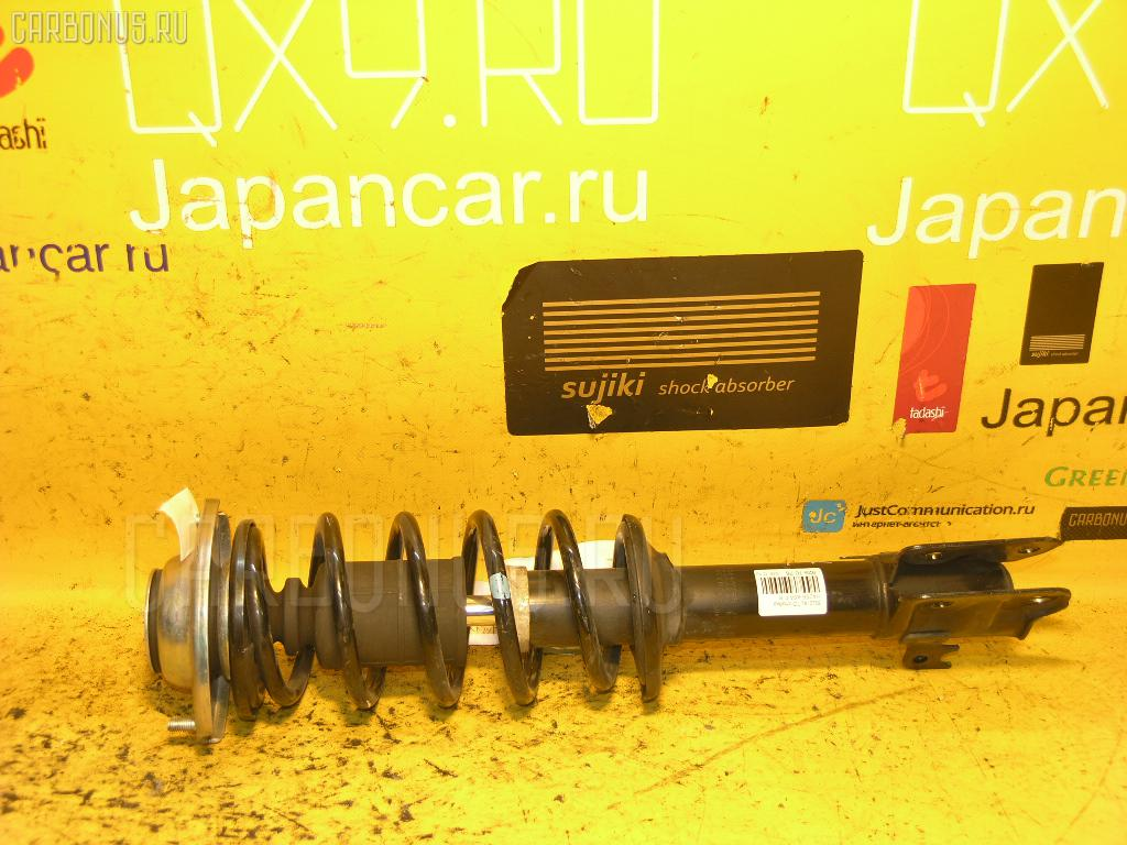 Стойка амортизатора Suzuki Alto HA25S K6A Фото 1