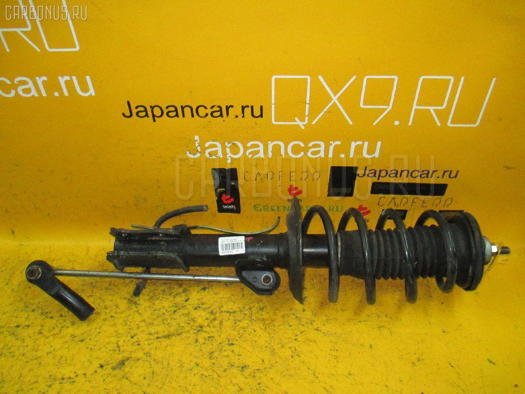 Стойка амортизатора Toyota Ist ZSP110 2ZR-FE Фото 1
