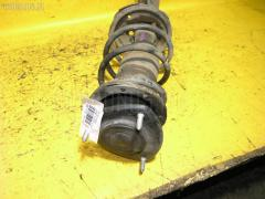 Стойка амортизатора Toyota Ist NCP65 1NZ-FE Фото 2