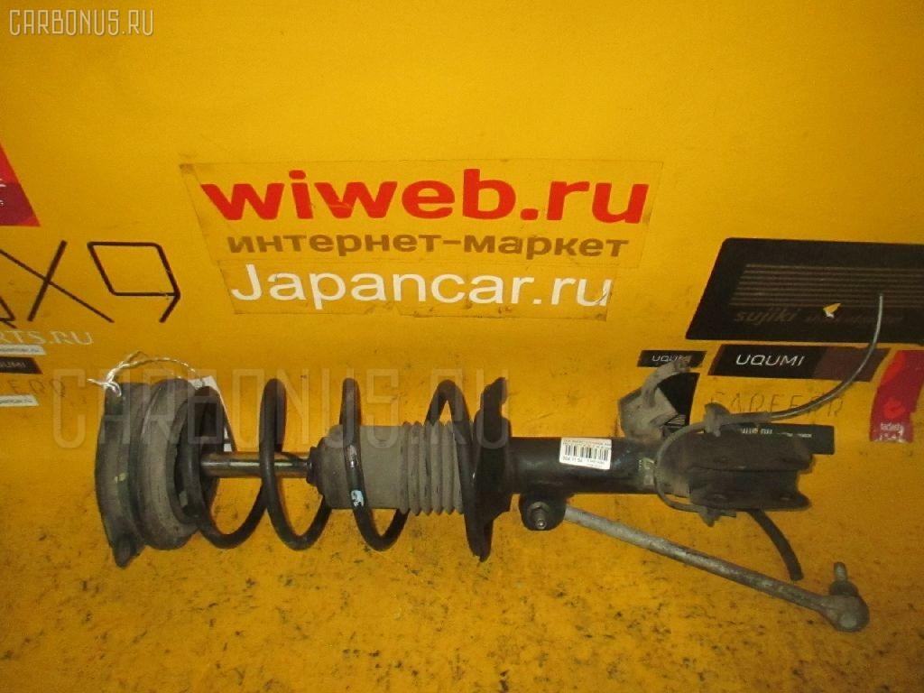 Стойка амортизатора на Nissan March K12 Фото 1