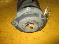 Стойка амортизатора на Nissan March AK12 Фото 1