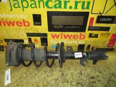 Стойка амортизатора NISSAN CUBE BZ11 CR14DE Переднее Левое