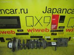 Стойка амортизатора SUBARU PLEO RA1 EN07 Переднее Левое