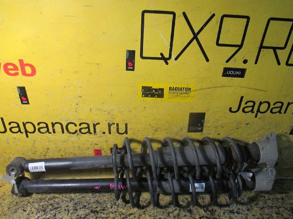 Амортизатор на Mazda Demio DY3W Фото 1