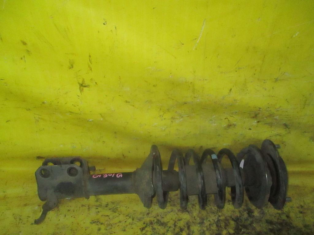 Стойка амортизатора 48510-87764 на Daihatsu Charade G200S Фото 1