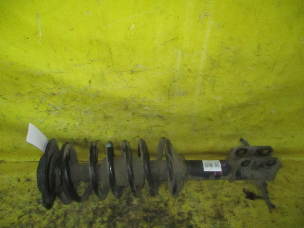 Стойка амортизатора 48520-87764 на Daihatsu Pyzar G303G Фото 1